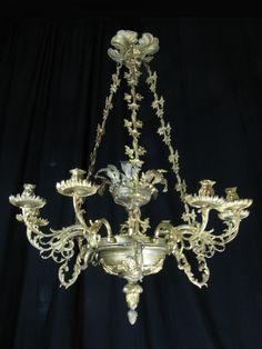 Lampadario in bronzo dorato e cristallo 9 luci