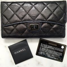 Authentic CHANEL Quilted Flap Wallet 100% authentic used metallic black quilted flap wallet with CHANEL authenticity card. Gunmetal hardware and inside snap closure. The edge of the flap and sides of wallet have been worn down - see above pictures. There also is some wear to the back of the wallet along with a knick on the hardware - please see additional post for these pictures. If you need any other photos or close ups please let me know. Sorry, no trades but offers are welcome! CHANEL…