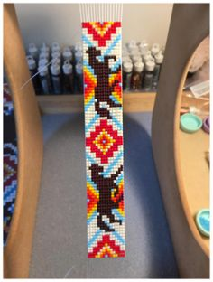Two color options to choose from—blues and pink OR red, orange and yellow! This is a fully adjustable, vegan, loom beaded bracelet made with the finest materials available. I weave each piece by hand with my little loom in Cumbria, England. Mustang Sally design features Miyuki Delica