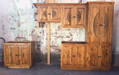 Google Image Result for http://www.greatswfurniture.com/images/southwest-style-kitchen-cabinets-in-pine-wood-with-sunburst-carvings-medium-brown.jpg