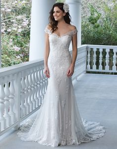 Sincerity+wedding+dress+style+3938+Show+off+your+shoulders+in+this+fit+and+flare+tulle+and+point+d'esprit+gown+with+lace+appliques,+illusion+back,+and+Jersey+lining+complete+with+a+chapel+length+train.+
