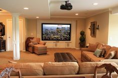 Entertain With Ease You may never see your family upstairs if the basement is outfitted with comfortable furniture and a high-def projection screen for the ultimate movie-watching experience.