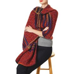 This snowy winter wrap yourself up in this colorblock wrap designed by Isaac Mizrahi. The thick colorful yarn is perfect for a cold weather wear.