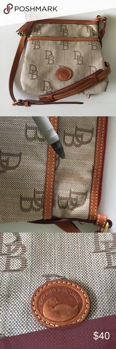 """DOONEY & BOURKE Canvas leather Cross Body Handbag There's on mark on the front that my pen is pointing to. I covered this up with the Tassel- although it's hard to see it's even there at all! Corners are a little dirty, on the exterior base. 8.5"""" x 9"""" x2.5"""" 22"""" strap drop. Dooney & Bourke Bags Crossbody Bags"""