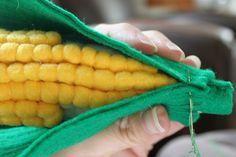 I heart fake food, is back!      Corn on the cob anyone?      Supplies:  Yellow, Green and Cream felt  Fiberfill  Yellow thread  Green thre...