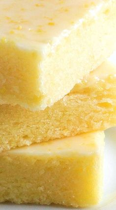 Best Ever Lemon Brownie Bars or Lemon Brownies ~ Fudgy, lemony and irresistible! The texture of these citrus bars is very similar to brownies and the glaze is like pure sunshine. Perfect for summer entertaining and picnics! Includes gluten free option.