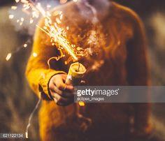 Stock Photo : Girl igniting smoke bomb
