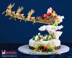 Santa's in Town Christmas Cake - Cake by Yeners Way - Cake Art Tutorials Christmas Themed Cake, Christmas Cake Designs, Christmas Cake Decorations, Christmas Sweets, Noel Christmas, Christmas Baking, Christmas Cakes, Anti Gravity Cake, Gravity Defying Cake