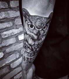 Forearm owl tattoo by Felipe Kross