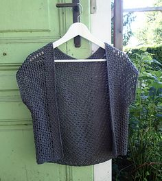 Tuwe, a Tunisian lace vest crocheted with Tunisian simple stitch and Tunisian purl stitch with a honeycomb border.