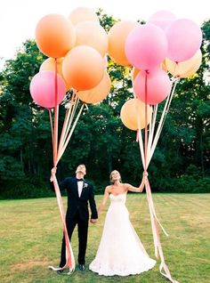 Bride and groom with balloons