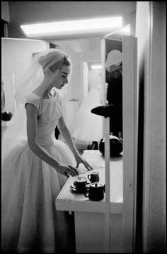 """Audrey Hepburn takes a tea break in her dressing room during the filming of """"Funny Face"""", 1957"""