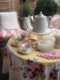 I like the idea of raising the teapot so its easy to get of hold of when the table is filled with goodies.