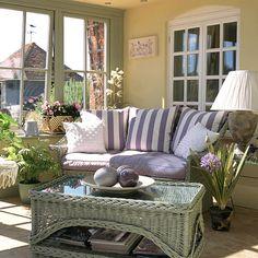 Lloyd loom furniture, pale green/grey woodwork on windows