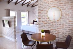 Our unique Self-Catering Village Studio Apartments are positioned above quaint shops in Village de Pont at the Winery. The apartments are open-plan and sleep up to a maximum of 4 guests, with one king-size bed and one bunk bed (ideal for kids). One Bed, Open Plan, Bunk Beds, Studio Apartments, Restaurant, King Size, Catering, Shops, Sleep