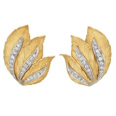 Pair of Two-Color Gold and Diamond Leaf Earclips, Mario Buccellati   18 kt., composed of overlapping textured yellow gold leaves, centering white gold veins set with 34 round diamonds approximately .75 ct., signed M. Buccellati, Italy, approximately 9.5 dwts.