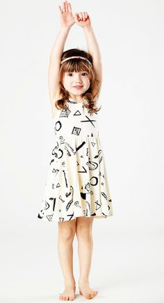 Twirling Dress in Black on Creme Snake Pyramid Print