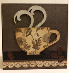 "Elizabeth Craft Designs:  Coffee Pop Stand (Pop it Ups); Coffee & Tea clear stamps; Coffee stage-it stencil.  Kaisercraft ""Art of Life"" paper; Tim Holtz Deco sheets (for steam); Ground Espresso distress ink, and Vintage Photo Embossing Powder.  Photo 1 of 2"