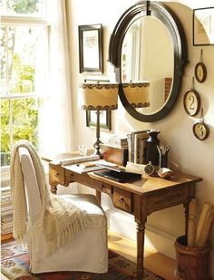 """""""Old desks with great legs are just fantastic. I love how they accented the light tones with the dark wood on the mirror and picture frames."""""""