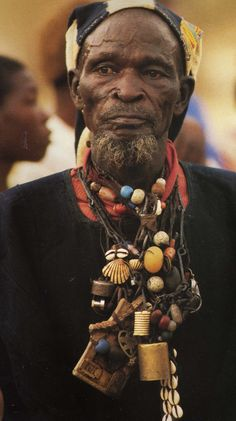 African elder man w trade bead necklaces, chams, amulets...