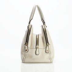 """J.Crew Bienniel Satchel $348    Crafted in supple pebbled leather, this sleek two-handle bag—a design team pick—has enough room for a mini-laptop, your lipstick and even your little cashmere cardigan. It's just what we've always wanted: a can-do carryall with effortless elegance. Zip closure. Brass-finish hardware. Interior patch pocket. Cotton twill lining. Comes with dust bag. Import. 6"""" handle drop. 11""""H x 16""""W x 7""""D."""