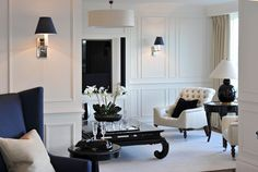 The team was commissioned to convert two apartments in a luxury riverside development in South West London into one impressive open-plan four bedroom apartment. The interior incorporates new timber flooring and bespoke wall panelling, complemented by classic contemporary furniture with luxurious finishes. Share