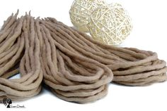Wool dreadlocks  Sweet Cafe Latte  DE  Type: Double Ended Material: Worsted wool Method: Felted, handmade Pieces in set: Choose the quantity in the listing options Lenght: 30-40 inch (80-100cm) - 15-20inch (40-50cm) folded in half Thickness: 0.39-0.79 inch (1-2cm) Color: dark blonde  Quantity: If you have a mohawk - 30 pieces will be enough If you have a thin hair - 40 pieces will be enough If you have a tchick hair - you need 50-60 pieces   Wool dreadlocks have many advantages:  * Light –…