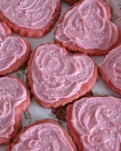 Easy cake mix Valentine cookies: 1 box of strawberry cake mix, 1 egg, 1 stick of butter, frosting, coarse sugar.