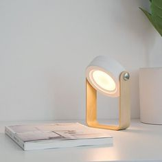 This fantastic, highly portable, collapsible lamp is perfect for a whole range of activities - from camping and  hiking to reading a book in bed!    Get your Portable Lamp now at RomeaDecor.com and enjoy 50% OFF   FREE Shipping. Lantern Lamp, Lanterns, Collapsible Desk, Mood Lamps, Wooden Handles, Led Lamp, Night Light, Bulb, Room Lights