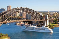 Silver Sea Cruise Ship passes under Syndey Harbour Bridge.