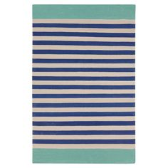 Bring visual appeal to your den or define areas in the living room with this hand-woven rug, showcasing a striped motif in beige and cobalt.