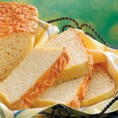 Cheddar-Topped English Muffin Bread Recipe -Slices of this firm bread have the great English muffin texture your family  is sure to love. A sprinkling of shredded cheddar cheese give a pretty golden-brown color to the top of the loaves.                                      —Anne Smithson of Cary, North Carolina