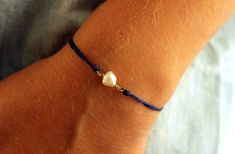 Freshwater pearl bracelet Bridesmaid gift jewelry Single pearl bracelet  White stone bracelet June birthstone jewelry Blue string bracelet by Amoreecolore on Etsy https://www.etsy.com/listing/249232750/freshwater-pearl-bracelet-bridesmaid