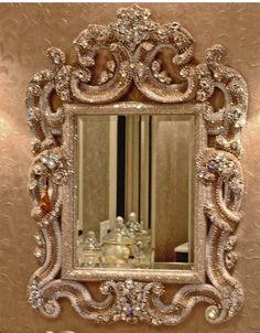 Sparkling up the frames of mirrors is such a great idea!