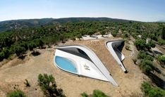 Summer house by LASSA offers elevated view over Greek olive grove