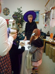 Volunteer Marcia the Witch mans the kids' craft and activities table at MEOW-loween