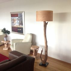 Floor Lamp manufacturing of weathered oak on Natural stone base.
