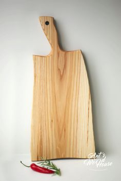 This WOODEN CUTTING BOARD is perfect for serving snacks and bread.  The dimensions: Width: 13 cm-17cm Length: 43,5 cm  The item is made out of ash