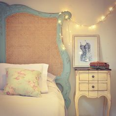love the rustic headboard, very french