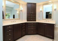 Corner double vanity with separate mirrors, lots of cabinet and drawer space