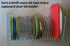 Thrift Store CD rack makes a great plastic ware lid organizer