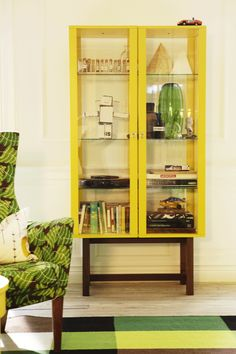 IKEA Stockholm collection... I like this shade of yellow, and I'd love a pretty place to display my nice things