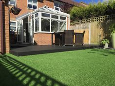 artificial grass and composite deck Artificial Grass Installation, Composite Decking, Composite Cladding