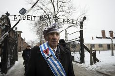 Auschwitz survivor Miroslaw Celka walks out the gate with the sign saying 'Work makes you free' after paying tribute to fallen comrades at the 'death wall' execution spot in the former Auschwitz concentration camp in Oswiecim, Poland, on the 70th anniversary of the liberation of the Nazi death camp on Jan. 27 PHOTO: AGENCE FRANCE-PESSE/GETTY IMAGES