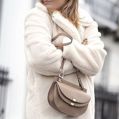 Teddy coats and Chloé bags. // Follow @ShopStyle on Instagram to shop this look
