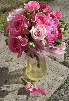 #pink prom bouquet of  #ranunculus, #roses, #spray roses, #hypericum and #feathers with a matching #boutonniere