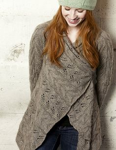 Knit an enveloping shawl-like cardigan with generous fronts that can be worn cascading open, or wrapped and pinned into a cozy wrap. This sweater is the perfect showcase for Schoppel-Wolle Cashmere Queen, a lightly felted DK-weight single that is a blend of soft wool, lustrous silk and feather light cashmere. The crisp stitch definition is ideal for the simple cables and delicate lace panels.