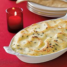 Garlic Mashed-Potato Gratin | MyRecipes.com - These garlic mashed potatoes are full of flavor and a great side dish to any meal. Enjoy this creamy and filling dish at your next family meal.