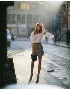 "afashionlines: ""https://www.pinterest.com/afashionlines/ "" I ❤️ her cute mini skirt and high heels, she has long sexy legs"