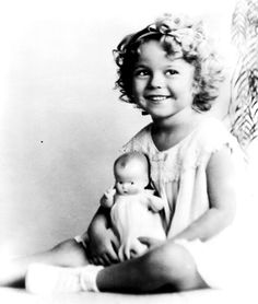 Shirley Temple-I loved her movies when I was a kid.  Mom got me a Shirley Temple doll when I was in my early 20s.  I sold it a few years later to get money for groceries when times we tough.  I never told my mom that I did that.